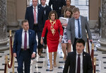 House Speaker Nancy Pelosi, D-Calif., walks from the chamber through Statuary Hall a day after the Democratic-controlled House of Representatives voted to impeach President Donald Trump on charges of abuse of power and obstruction of Congress, at the Capitol in Washington, Wednesday, Dec. 18, 2019. (AP Photo/J. Scott Applewhite)