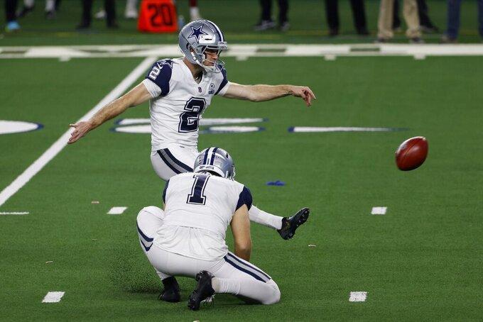Dallas Cowboys' Hunter Niswander (1) holds as place kicker Greg Zuerlein (2) kicks a field goal in the second half of an NFL football game against the Washington Football Team in Arlington, Texas, Thursday, Nov. 26, 2020. (AP Photo/Ron Jenkins)