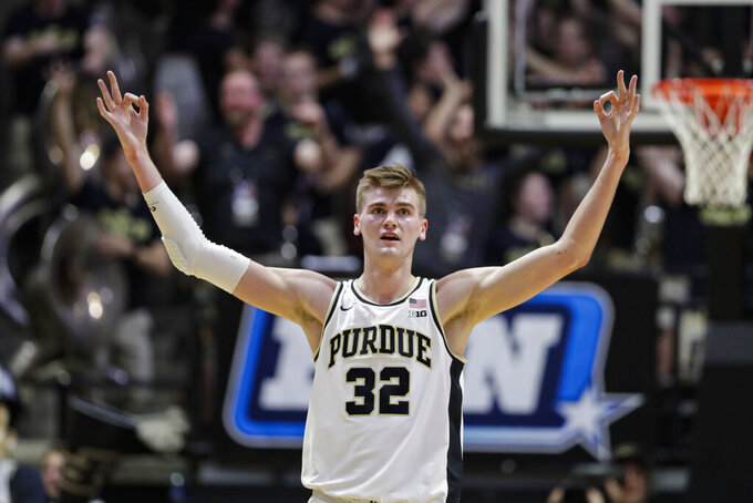 Purdue center Matt Haarms (32) celebrates during the second half of the team's NCAA college basketball game against Iowa in West Lafayette, Ind., Wednesday, Feb. 5, 2020. Purdue defeated Iowa 104-68. (AP Photo/Michael Conroy)