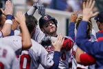 Minnesota Twins designated hitter Josh Donaldson is greeted in the dugout after a two-run home run during the fourth inning of a baseball game against the Detroit Tigers, Monday, Aug. 30, 2021, in Detroit. (AP Photo/Carlos Osorio)