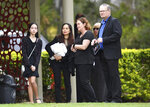 Family and friends of Bernard Prendergast attend his funeral in Brisbane, Thursday, Sept. 10, 2020. Prendergast's daughter, Sarah Caisip was refused permission to go to the funeral because she was forced to spend 14 days in hotel quarantine. (Darren England/AAP Image via AP)