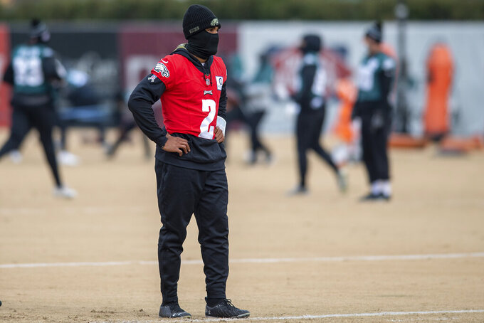 Philadelphia Eagles quarterback Jalen Hurts looks on during practice at the NFL football team's training facility, Wednesday, Dec. 9, 2020, in Philadelphia. (Jose F. Moreno/The Philadelphia Inquirer via AP, Pool)