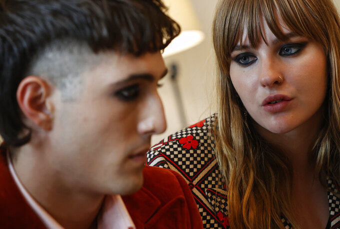 Victoria De Angelis, bass player of Italian band Maneskin band, winners of the Eurovision Song Contest in May, looks at frontman Damiano David, left, during an interview with the Associated Press at a hotel in Rome, Tuesday, July 27, 2021. (AP Photo/Riccardo De Luca)