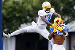 Los Angeles Chargers free safety Derwin James, right, intercepts a pass intended for Los Angeles Chargers wide receiver Keenan Allen during NFL football practice in Costa Mesa, Calif., Friday, Aug. 6, 2021. (AP Photo/Alex Gallardo)