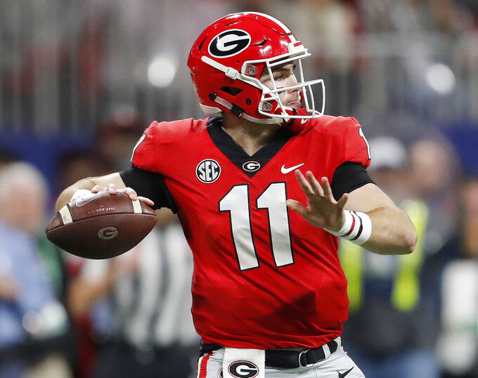 FILE - In this Dec. 1, 2018, file photo, Georgia quarterback Jake Fromm (11) works against Alabama during the first half of the Southeastern Conference championship NCAA college football game, in Atlanta. With the departure of Jim Chaney to Tennessee and James Coley now running Georgia's offense, coach Kirby Smart says there are no plans for dramatic changes. With third-year starting quarterback Jake Fromm in charge, there's no need for dramatic changes. (AP Photo/John Bazemore, File)
