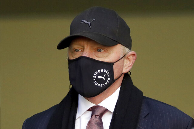 Retired German tennis player Boris Becker leaves Westminster Magistrates Court in London, after being declared bankrupt and accused of not complying with obligations to disclose information, Thursday, Sept. 24, 2020. Becker is being prosecuted by the Insolvency Service. (AP Photo/Matt Dunham)
