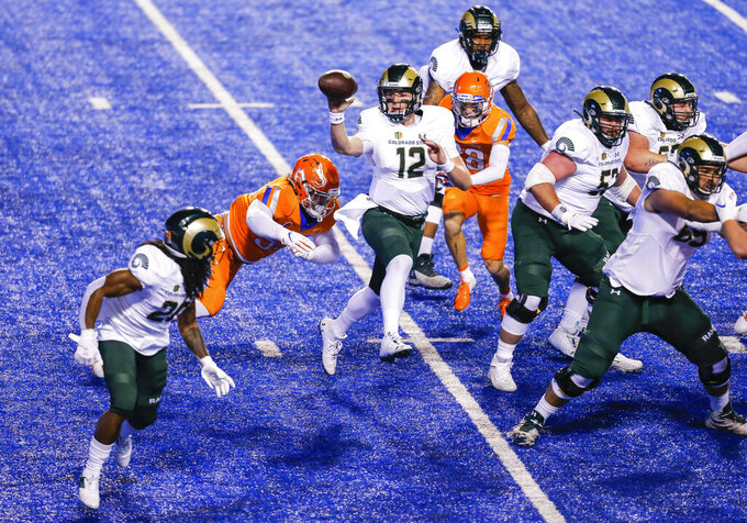 Colorado State quarterback Patrick O'Brien (12) tosses the ball to wide receiver A'Jon Vivens (20) during the first quarter of the team's NCAA college football game against Boise State on Thursday, Nov. 12, 2020, in Boise, Idaho. (AP Photo/Steve Conner)