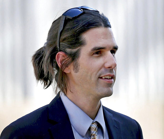 FILE - In this 2018 file photo border activist Scott Warren, who is charged with immigrant harboring, walks into federal court in Tucson, Ariz. Closing arguments were scheduled Wednesday, Nov. 20, 2019, at Warren's trial. Prosecutors say Warren, a member of a group that tries to prevent immigrant deaths in the desert, tried to hide two Central American immigrants at a camp in southern Arizona. Warren has denied helping hide immigrants. (Kelly Presnell/Arizona Daily Star via AP, File)
