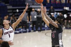 Santa Clara guard Giordan Williams (4) shoots over Gonzaga guard Jalen Suggs (1) during the first half of an NCAA college basketball game in Spokane, Wash., Thursday, Feb. 25, 2021. (AP Photo/Young Kwak)