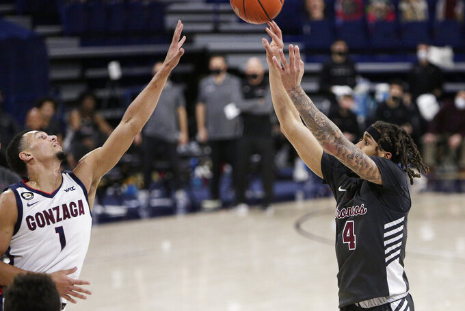 Santa Clara guard Giordan Williams (4) shoots over Gonzaga guard Jalen Suggs (1) during the first half of an NCAA college basketball game in Spokane, Wash., Thursday, Feb. 25, 2021. (AP Photo/Young Kwak)