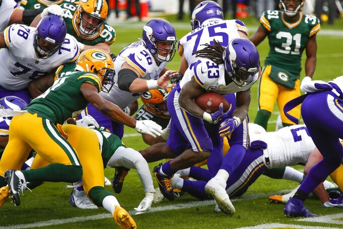 Minnesota Vikings' Dalvin Cook runs for a touchdown during the first half of an NFL football game against the Green Bay Packers Sunday, Nov. 1, 2020, in Green Bay, Wis. (AP Photo/Matt Ludtke)