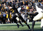Missouri quarterback Drew Lock scores on a 3-yard touchdown run during the second half of an NCAA college football game against Vanderbilt Saturday, Nov. 10, 2018, in Columbia, Mo. Missouri won 33-28. (AP Photo/Jeff Roberson)