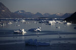FILE - In this Tuesday, Aug. 1, 2017, file photo, icebergs float in the Nuup Kangerlua Fjord after breaking off a glacier on Greenland's ice sheet in southwestern Greenland. In a year of cataclysm, some world leaders at September 2020's annual United Nations meeting are taking the long view, warning: If COVID-19 doesn't kill us, climate change will. With Siberia seeing its warmest temperature on record this year and enormous chunks of ice caps in Greenland and Canada sliding into the sea, countries are acutely aware there's no vaccine for global warming. (AP Photo/David Goldman, File)