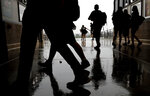 Fans leave during a rain delay in the fifth inning of a baseball game between the Toronto Blue Jays and the Chicago White Sox, in Chicago, Saturday, May 18, 2019. (AP Photo/Nam Y. Huh)