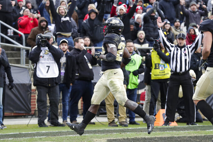 Purdue running back King Doerue (22) runs in for a touchdown against Nebraska during the first half of an NCAA college football game in West Lafayette, Ind., Saturday, Nov. 2, 2019. (AP Photo/Michael Conroy)