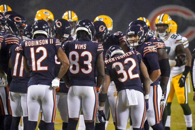 The Chicago Bears huddle during the first half of an NFL football game against the Green Bay Packers Sunday, Jan. 3, 2021, in Chicago. (AP Photo/Nam Y. Huh)