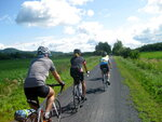 Cyclists on Velo Quebec's Grand Tour sweep along a trail in the Eastern Townships, Aug. 1, 2015. More than 1,200 cyclists took part in the ride, which dipped into Vermont. This year's Grand Tour is in the Saguenay-Lac Saint-Jean region. Velo Quebec is steward of Route Verte, a vast network of bicycle routes that has made Quebec a leading destination for cyclists. (AP Photo/Cal Woodward)