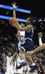 Rhode Island's Fatts Russell (1) drives past St. Bonaventure's LaDarien Griffin (15) during the second half of an NCAA college basketball game in the semifinal round of the Atlantic 10 men's tournament Saturday, March 16, 2019, in New York. St. Bonaventure won 68-51. (AP Photo)
