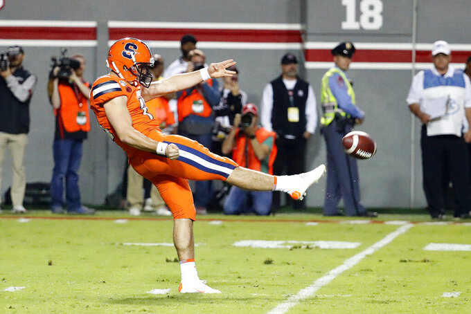 File- This Oct. 10, 2019, file photo shows Syracuse's Sterling Hofrichter (10) punting the ball against the North Carolina State during the first half of an NCAA college football game in Raleigh, N.C. Syracuse has a terrific 1-2 punch in Hofrichter and place-kicker Andre Szmyt. Together they've helped the Orange excel on special teams for a second straight season. Hofrichter has landed 93 of his 255 career punts inside the 20-yard line with only 13 touchbacks. (AP Photo/Karl B DeBlaker, File)