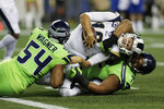 Los Angeles Rams quarterback Jared Goff, center, is tackled by Seattle Seahawks defensive tackle Al Woods, right, and middle linebacker Bobby Wagner (54) as Goff fails to make a 2-point conversion during the second half of an NFL football game Thursday, Oct. 3, 2019, in Seattle. (AP Photo/Stephen Brashear)