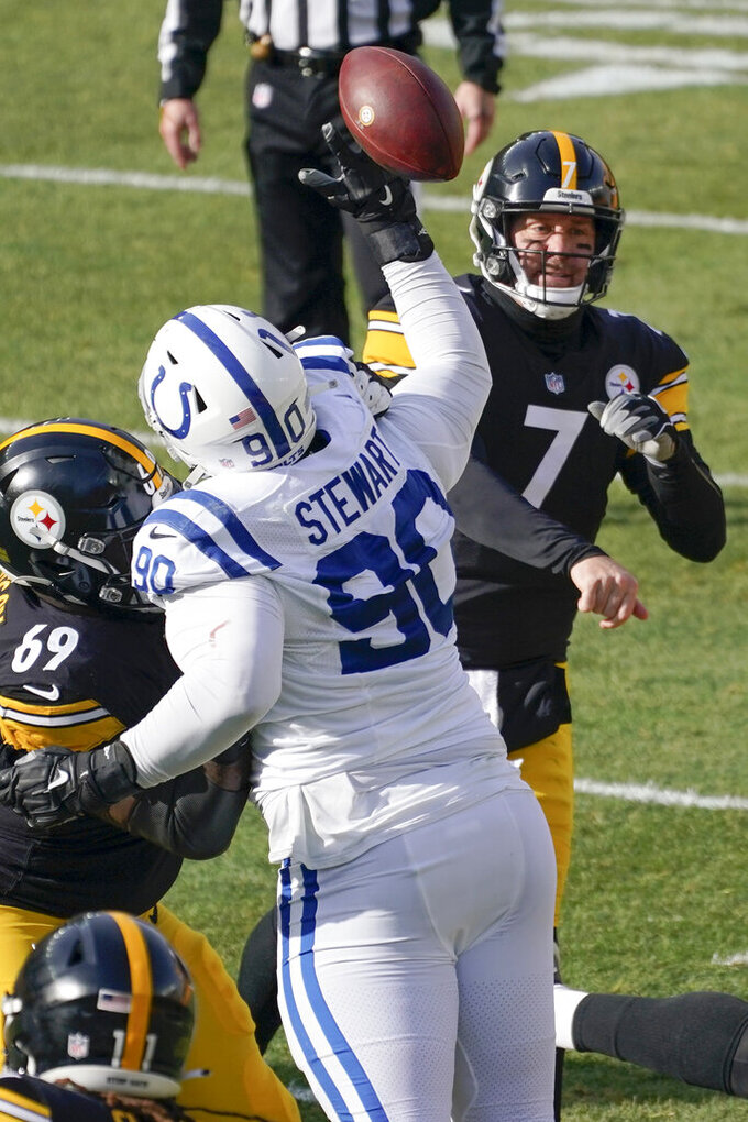 Indianapolis Colts defensive tackle Grover Stewart (90) tips a pass by Pittsburgh Steelers quarterback Ben Roethlisberger (7) during the first half of an NFL football game, Sunday, Dec. 27, 2020, in Pittsburgh. (AP Photo/Gene J. Puskar)