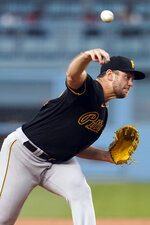 Pittsburgh Pirates starting pitcher Wil Crowe throws to a Los Angeles Dodgers batter during the first inning of a baseball game Tuesday, Aug. 17, 2021, in Los Angeles. (AP Photo/Marcio Jose Sanchez)