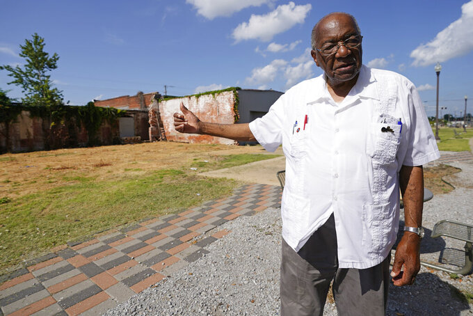 State Sen. David Jordan, D-Greenwood, gestures, July 14, 2021, towards a possible site for a memorial statue in Rail Spike Park, in Greenwood, Miss., recognizing Emmett Till, a 14-year-old African American teen who was beaten and killed in 1955, after he was accused of whistling at a white woman at her family's store. For more than a century, one of Mississippi's largest and most elaborate Confederate monuments has looked out over the lawn at the courthouse in the center of Greenwood. It's a Black-majority city with a rich civil rights history. Officials voted last year to remove the statue, but little progress has been made to that end. (AP Photo/Rogelio V. Solis)