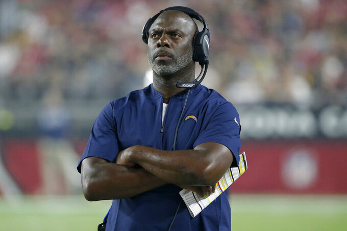 Los Angeles Chargers head coach Anthony Lynn watches during the first half of an NFL preseason football game against the Arizona Cardinals, Thursday, Aug. 8, 2019, in Glendale, Ariz. (AP Photo/Rick Scuteri)