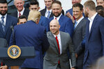 President Donald Trump, left, shakes hands with Steve Pearce, center, during a ceremony on the South Lawn of the White House in Washington, Thursday, May 9, 2019, where he honored the 2018 World Series Baseball Champion Boston Red Sox.(AP Photo/Pablo Martinez Monsivais)