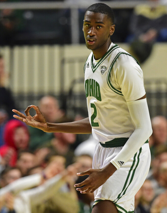 Ohio forward Nate Springs celebrates after hitting a 3-point shot during the first half of an NCAA college basketball game against Purdue, Tuesday, Dec. 17, 2019, in Athens, Ohio. (AP Photo/David Dermer)