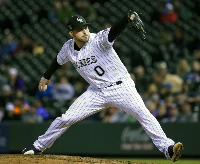 FILE - In this June 19, 2018, file photo, Colorado Rockies relief pitcher Adam Ottavino throws against the New York Mets during the seventh inning of a baseball game in Denver. A person familiar with the negotiations says reliever Adam Ottavino and the New York Yankees have agreed to a $27 million, three-year contract. The person spoke to The Associated Press on condition of anonymity Thursday, Jan. 17, 2019, because the deal was subject to a successful physical. (AP Photo/Jack Dempsey, File)