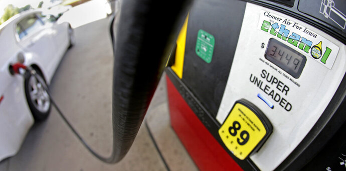 FILE - In this July 26, 2013, file photo, a motorist fills up with gasoline containing ethanol in Des Moines. The Trump administration says Friday, Oct. 4, 2019, it plans to implement new rules that will increase demand for ethanol, reversing a decline caused by exemptions given to oil refineries. (AP Photo/Charlie Riedel, File)