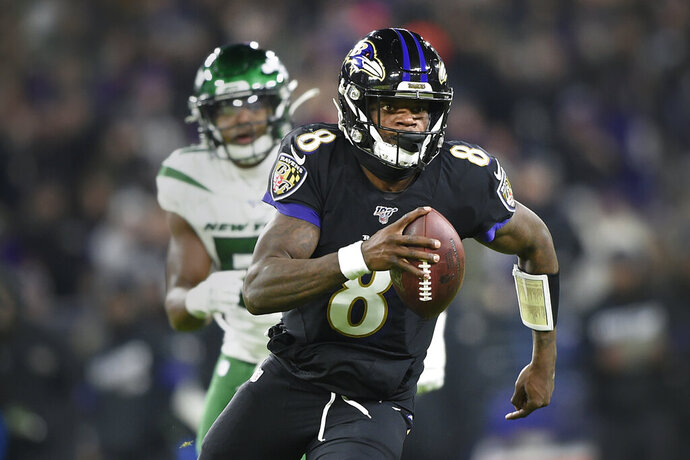 FILE - In this Dec. 12, 2019, file photo, Baltimore Ravens quarterback Lamar Jackson (8) runs with the ball as New York Jets outside linebacker Brandon Copeland (51) chases him during the first half of an NFL football game, in Baltimore. The Ravens bring a 12-game winning streak into their playoff matchup with the Tennessee Titans in Saturday night.(AP Photo/Gail Burton, File)