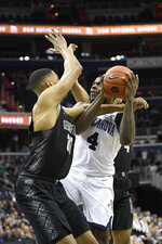 Georgetown forward Trey Mourning (33) fouls Villanova forward Eric Paschall (4) during the first half of an NCAA college basketball game, Wednesday, Feb. 20, 2019, in Washington. (AP Photo/Nick Wass)