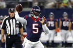 Houston Texans quarterback Tyrod Taylor throws a pass in the first half of a preseason NFL football game in Arlington, Texas, Saturday, Aug. 21, 2021. (AP Photo/Ron Jenkins)