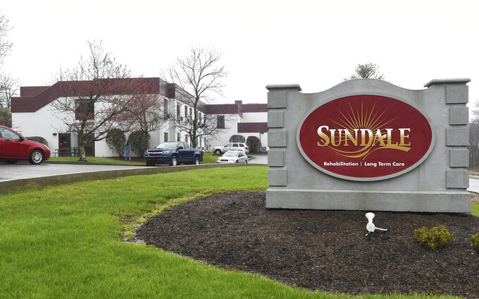 FILE - In this March 25, 2020, file photo, a Sundale nursing home sign sits on the property in Morgantown, W.Va., where several people have tested positive for the coronavirus. Nursing homes across the country went into lockdown this month with mandatory measures to protect their frail, elderly residents from coronavirus, but an alarming wave of deadly outbreaks nearly every day since suggests the steps that included a ban on visits and daily health screenings of staffers either came too late or were not rigorous enough. (Ron Rittenhouse/Dominion Post via AP, File)