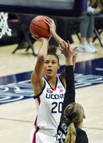 Connecticut forward Olivia Nelson-Ododa (20) shoots against Butler forward Ellen Ross (25) in the first half of an NCAA college basketball game Tuesday, Jan. 19, 2021, in Storrs, Conn. (David Butler II/Pool Photo via AP)