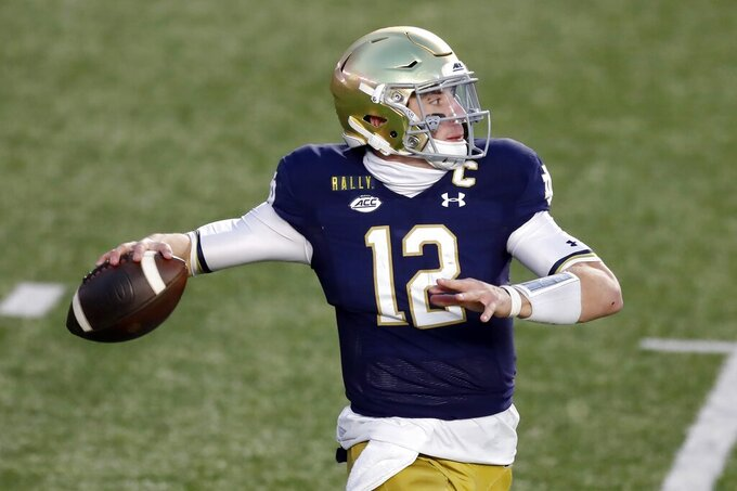 Notre Dame quarterback Ian Book looks to pass during the first half of an NCAA college football game against Boston College, Saturday, Nov. 14, 2020, in Boston. (AP Photo/Michael Dwyer)