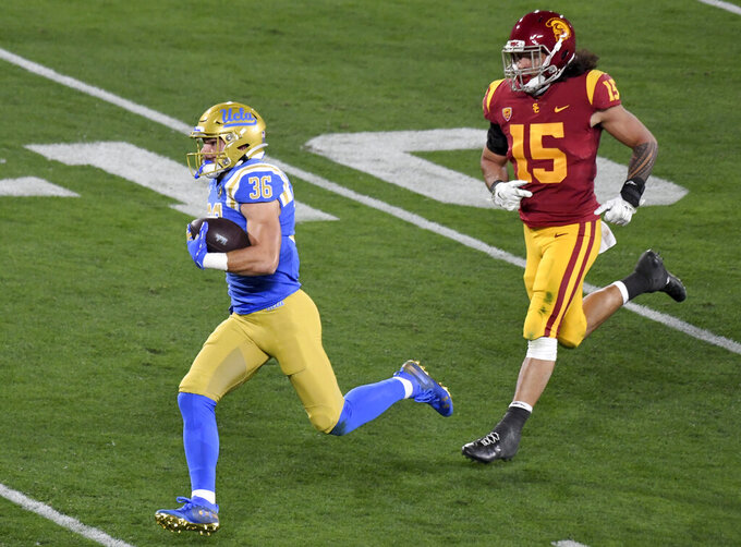 Wide receiver Ethan Fernea #36 of the UCLA Bruins catches pass and runs for touchdown past safety Talanoa Hufanga #15 of the USC Trojans in the first half of a NCAA Football game at the Rose Bowl in Pasadena on Saturday, December 12, 2020. (Keith Birmingham/The Orange County Register via AP)