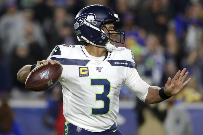 Seattle Seahawks quarterback Russell Wilson passes against the Los Angeles Rams during the first half of an NFL football game Sunday, Dec. 8, 2019, in Los Angeles. (AP Photo/Marcio Jose Sanchez)