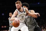 Brooklyn Nets center Jarrett Allen, right, defends against Indiana Pacers forward Domantas Sabonis (11) during the first half of an NBA basketball game, Monday, Nov. 18, 2019, in New York. (AP Photo/Kathy Willens)