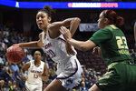 "FILE - Connecticut's Olivia Nelson-Ododa, left, drives around South Florida's Tamara Henshaw during the first half of an NCAA college basketball game in the American Athletic Conference tournament semifinals at Mohegan Sun Arena, Sunday, March 8, 2020, in Uncasville, Conn. UConn officials have discussed creating helmet stickers, warm-up T-shirts and altering athletic uniforms in other ways to show support for the Black Lives Matter movement. ""I believe as athletes that we have this platform, especially here, we have a platform and a voice and we should use it, especially on topics like this that have been going on for hundreds of years,"