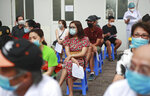People wait in line to be tested for COVID-19 in Hanoi, Vietnam on Friday, July 31, 2020. Vietnamese state media on Friday reported the country's first-ever death of a person with the coronavirus as it struggles with a renewed outbreak after 99 days without any cases.(AP Photo/Hau Dinh)