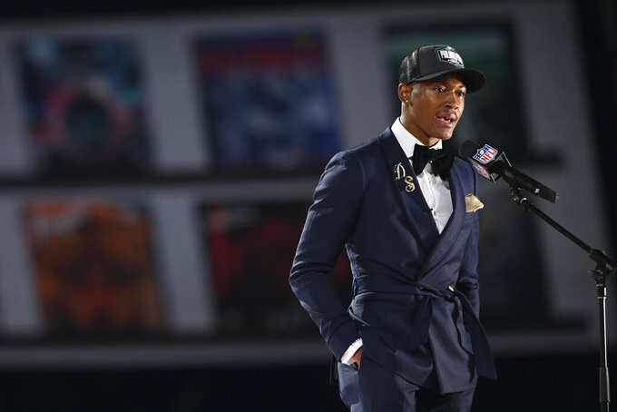Alabama wide receiver DeVonta Smith speaks after he was chosen by the Philadelphia Eagles with the 10th pick in the first round of the NFL football draft Thursday April 29, 2021, in Cleveland. (AP Photo/David Dermer)