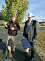 CORRECTS TO SAY WHAT AUTHORITIES THOUGHT WERE THE REMNANTS OF AN EXPLOSIVE DEVICE TURNED OUT TO BE NONEXPLOSIVE MATERIALS - Lewis and Clark County Undersheriff Jason Grimmis, left, and Sheriff Leo Dutton, right, update reporters on what they thought was a homemade bomb that detonated in an elementary school playground on Tuesday, Oct. 15, 2019, in Helena, Mont. Authorities evacuated the elementary school in Montana's capital city Tuesday after officials found what they thought were the remnants of a homemade bomb, but they turned out to be a plastic bottle filled with nuts and bolts left in the schoolyard. (AP Photo/Amy Beth Hanson)