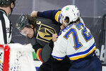 Vegas Golden Knights right wing Mark Stone, left, fights with St. Louis Blues defenseman Justin Faulk (72) during the second period of an NHL hockey game Tuesday, Jan. 26, 2021, in Las Vegas. (AP Photo/John Locher)
