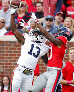 Auburn defensive back Javaris Davis (13) knocks a pass away from Mississippi wide receiver Braylon Sanders (13) during the first half of an NCAA college football game on Saturday, Oct. 20, 2018, in Oxford, Miss. (AP Photo/Rogelio V. Solis)