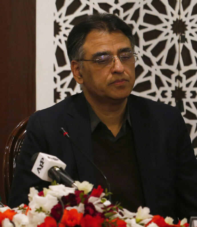 FILE - In this Tuesday, Feb. 26, 2019 file photo, Pakistan's Finance Minister Asad Umar attend a meeting in Islamabad, Pakistan. Pakistan's finance minister says he will step down amid a wave of criticism over the government's handling of a financial crisis that has sent prices soaring. Umar tweeted Thursday, April 18, 2019 that Prime Minister Imran Khan offered him the energy portfolio in the Cabinet but he refused. He defended Khan's leadership, calling him the