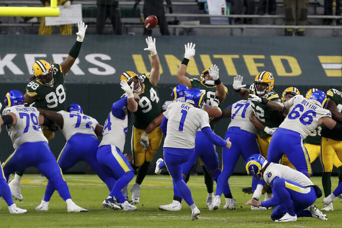 Los Angeles Rams kicker Matt Gay (1) kicks a field goal during the first half of an NFL divisional playoff football game against the Green Bay Packers, Saturday, Jan. 16, 2021, in Green Bay, Wis. (AP Photo/Mike Roemer)