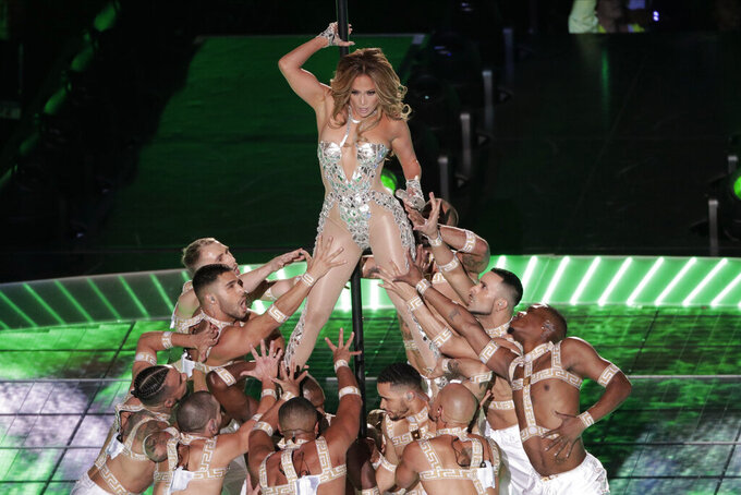 Jennifer Lopez performs, during the halftime show at the NFL Super Bowl 54 football game between the San Francisco 49ers and Kansas City Chiefs', Sunday, Feb. 2, 2020, in Miami Gardens, Fla. (AP Photo/Charlie Riedel)